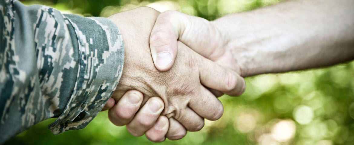 Military and civilian handshake